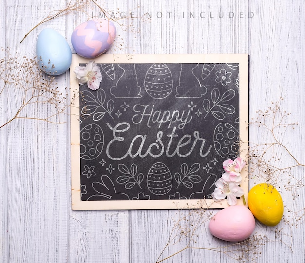 Colorful easter eggs with flowers on wooden surface. a chalk board mockup
