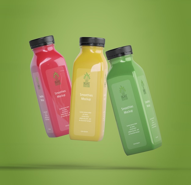Colorful smoothies on green background