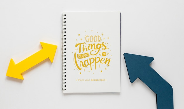 Colourful arrows and notebook mock-up