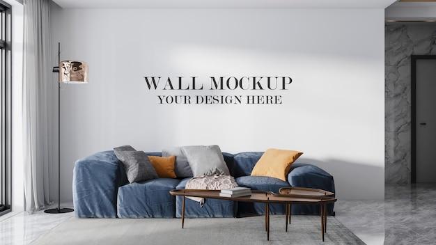 Удобный синий диван перед стенным макетом