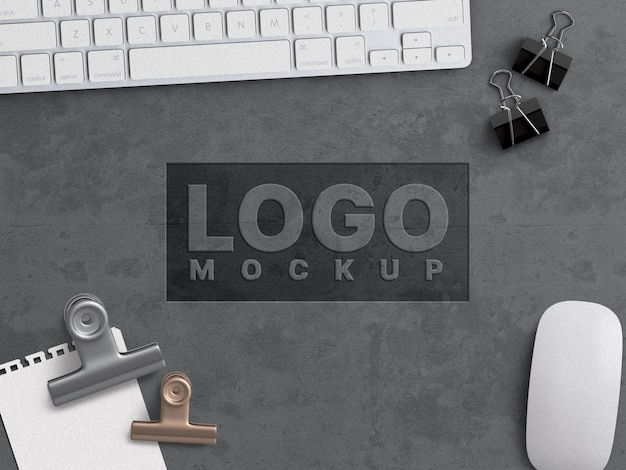 Company business logo mockup work concept carved on grunge concrete surface with office appliances