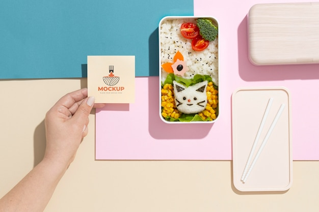 Composition of bento box with mock-up card