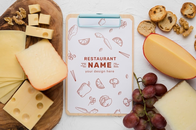Composition of delicious foods with clipboard mock-up