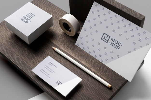 Composition of mock-up stationery on wood