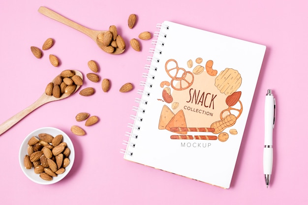 Composition of snacks with notebook mock-up