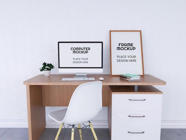 机の上のコンピューターとフォトフレームのモックアップ