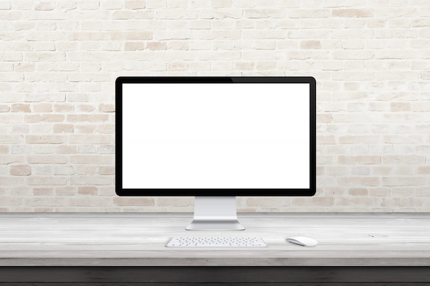 Computer display mockup on wooden desk with brick wall