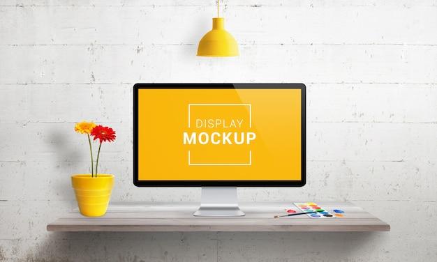 Computer display mockup on wooden desk. Premium Psd