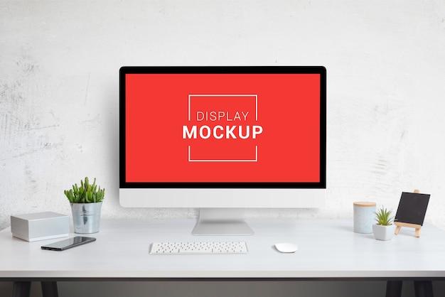 Computer display mockup on work desk