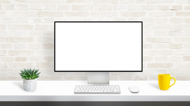 Computer display with isolated, blank, white screen for web site presentation mockup. concept of designer studio