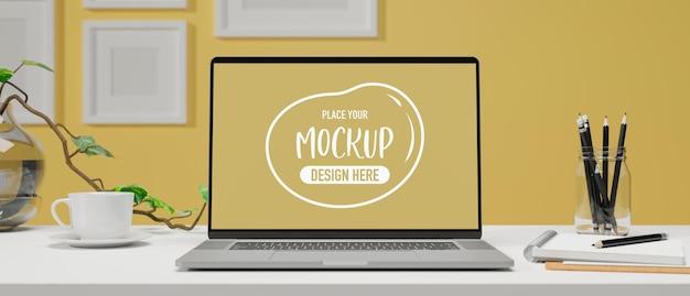 ホーム オフィス ルームの 3d レンダリングに文房具を備えたテーブルにモックアップ画面を備えたコンピューター ラップトップ
