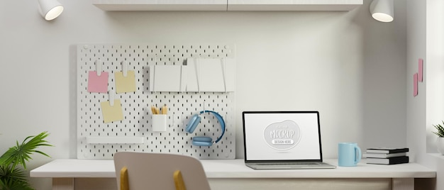 Computer mockup screen on white table with stationery