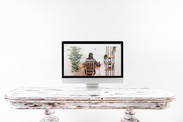 Computer mockup on wooden desk