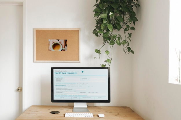 Computer mockup on a wooden table for work from home during corona outbreak