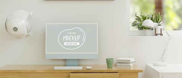 ホーム オフィス ルームの 3 d レンダリングで木製のテーブルにモックアップ画面を備えたコンピューター モニター