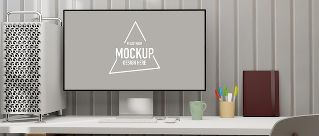 Computer monitor with mockup screen on white table with cpu case and stationery 3d rendering