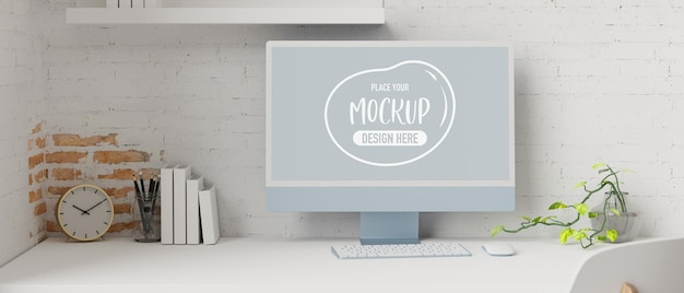 Computer monitor with mockup screen in workspace with stationery