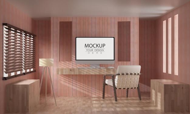 作業スペースのモックアップのテーブル上のコンピュータ