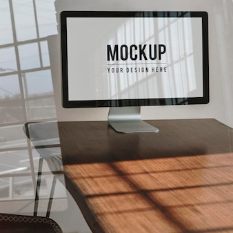 Computer screen mockup on a wooden table