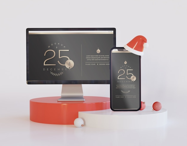 Computer screen and smartphone mockup with christmas decoration