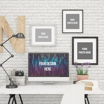 Computer screen and three photo frames mock up in modern office