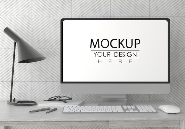 Computer on table in work space psd mockup