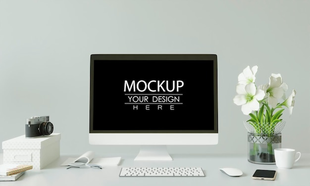 Computer on table in workspace mockup