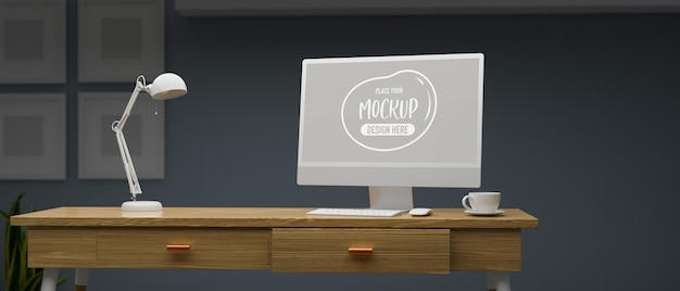 Computer with mockup screen on wooden table with lamp in home office room at night 3d rendering