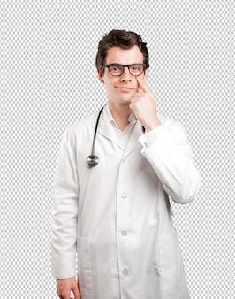 Concentrated doctor with observe gesture against white background