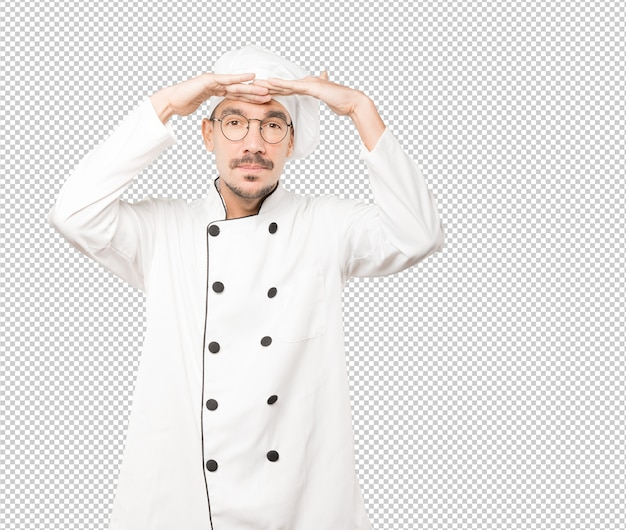 Concentrated young chef with a gesture of looking away