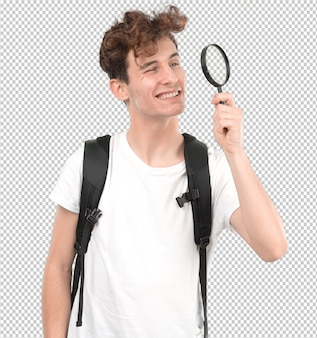 Concentrated young student using a magnifying glass