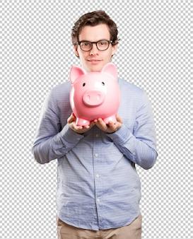 Концепция довольного молодого человека, экономя деньги