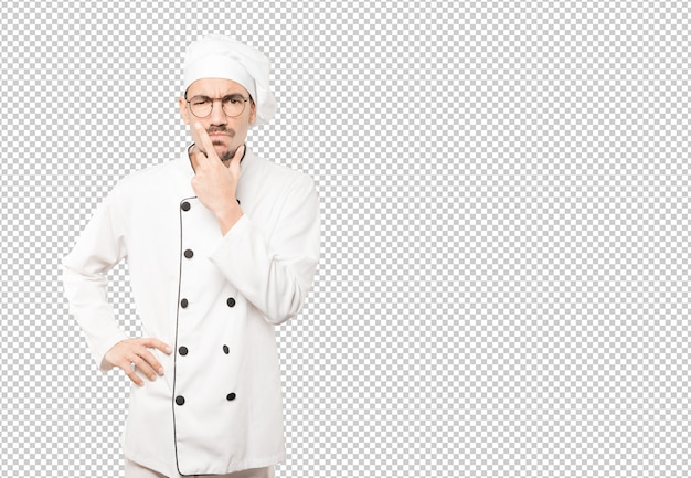 Concerned young chef making a gesture of doubt