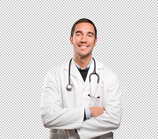 Confident doctor against white background