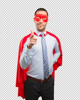Confident super businessman pointing