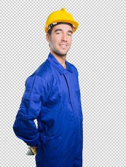 Уверенный рабочий на белом фоне