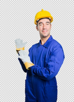Confident workman welcoming on white background