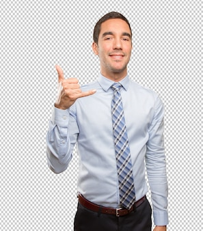 Confident young businessman doing a call gesture