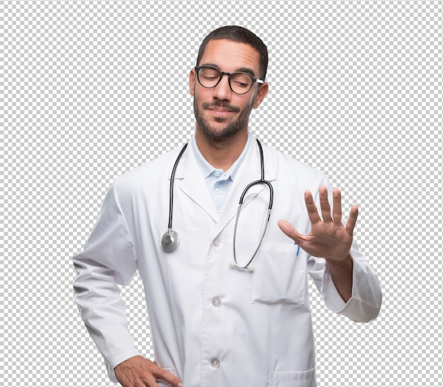 Confident young doctor doing a keep calm gesture