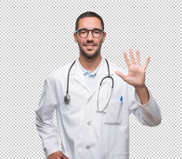 Confident young doctor with a gesture of number five