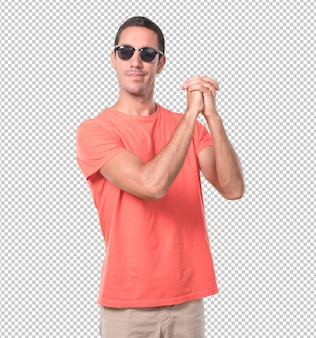 Confident young man doing a gesture of unity