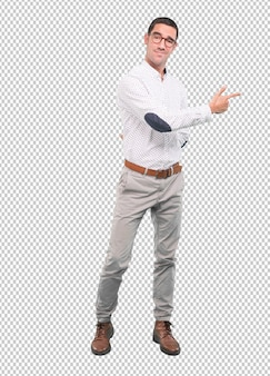 Confident young man pointing with his hand - full body shot