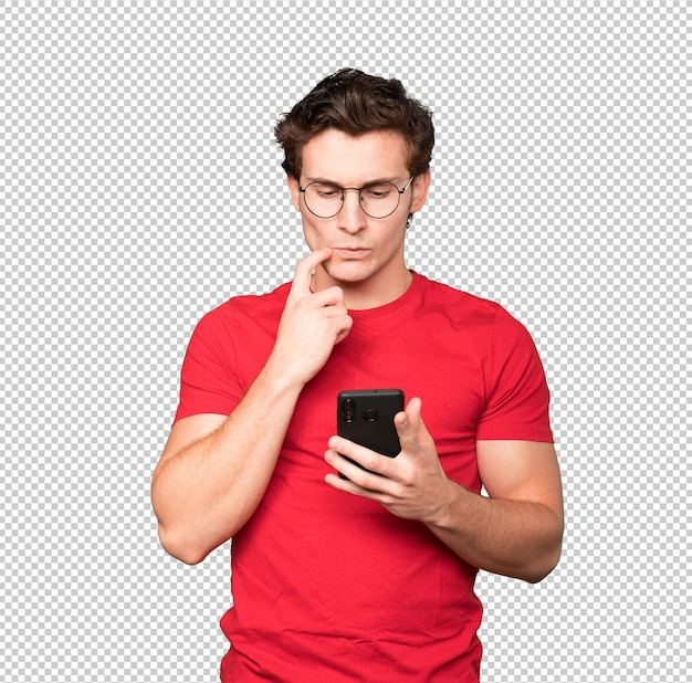 Confused young man using a mobile phone