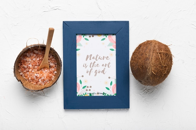 Consciousness quote in frame next to coconut
