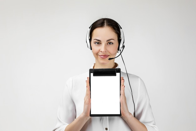 Consultant of call center in headphones holding clipboard