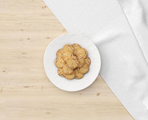 Тарелка печенья на деревянном столе Бесплатные Psd