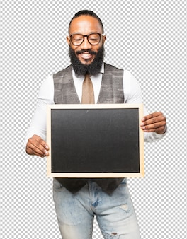 Cool black man with a blank blackboard