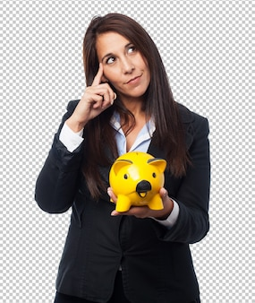 Cool business-woman with piggy-bank