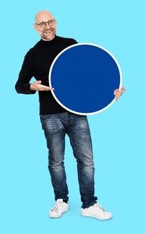 Cool entrepreneur holding a blank circles