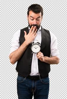 Cool man holding vintage clock